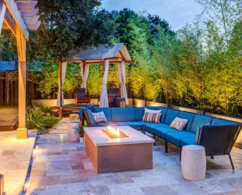 An outdoor Design + Build project featuring a fire pit and trellis.