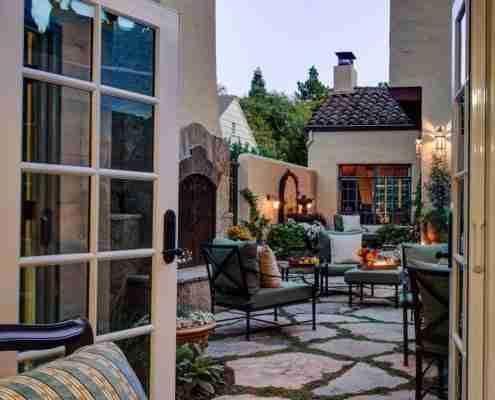 view of outdoor seating area through doors