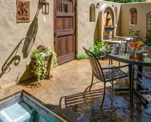 outdoor seating with wooden door and pool