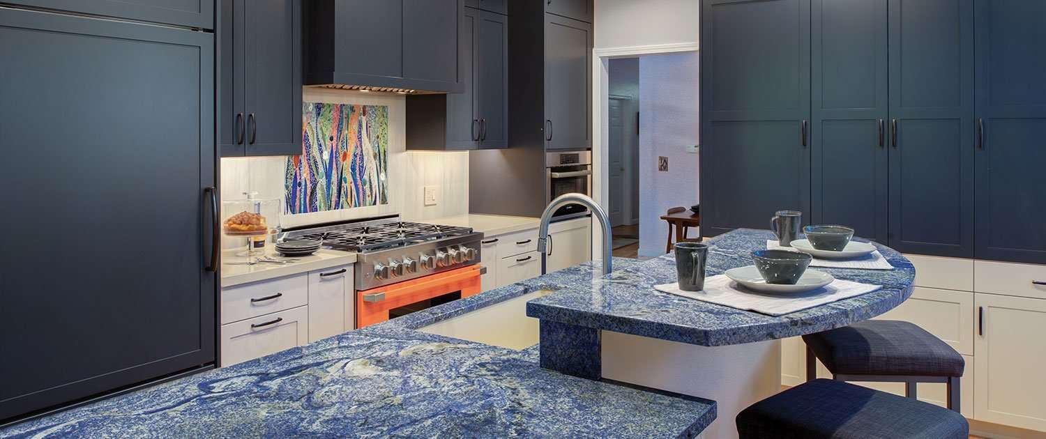 A Harrell Remodeling, Inc. Design + Build kitchen showcases a brightly colored appliance and contrasting cabinetry.
