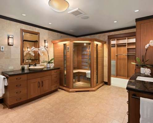 A large universal design bathroom has ample space for a sauna and walk-in closet.