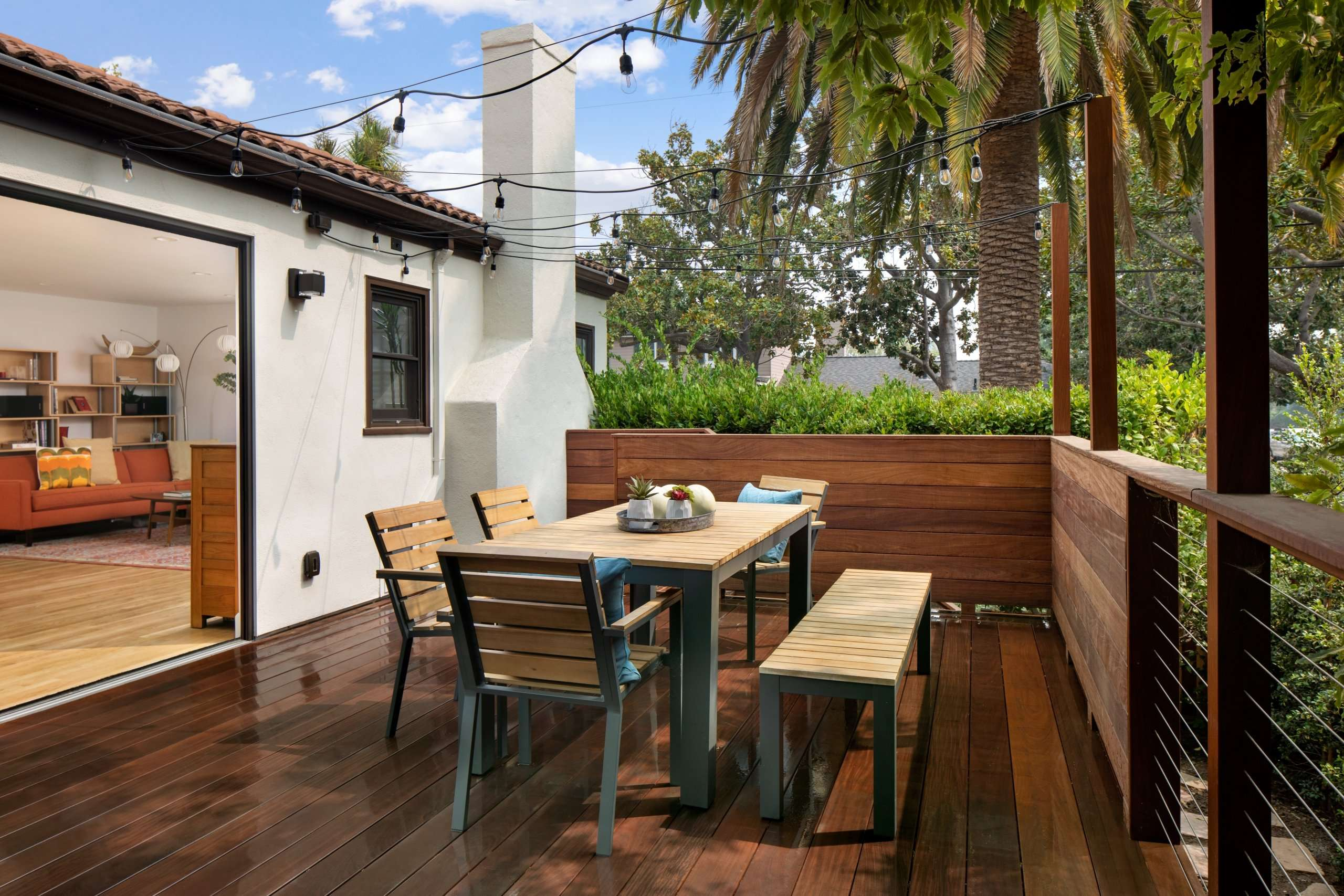 Beautiful outdoor dining table on wooden deck