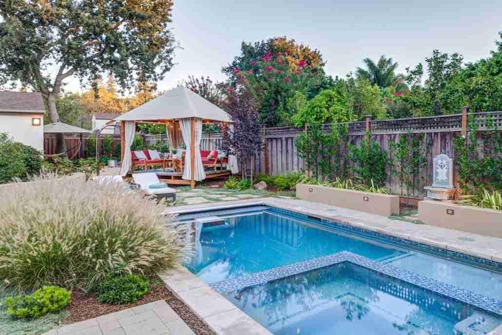 gazebo outdoor seating and pool daytime