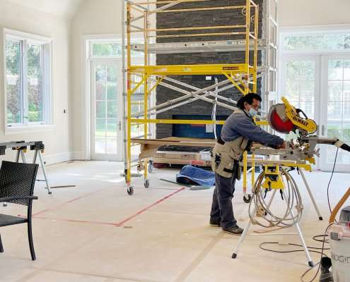 Workers remodeling inside of a house