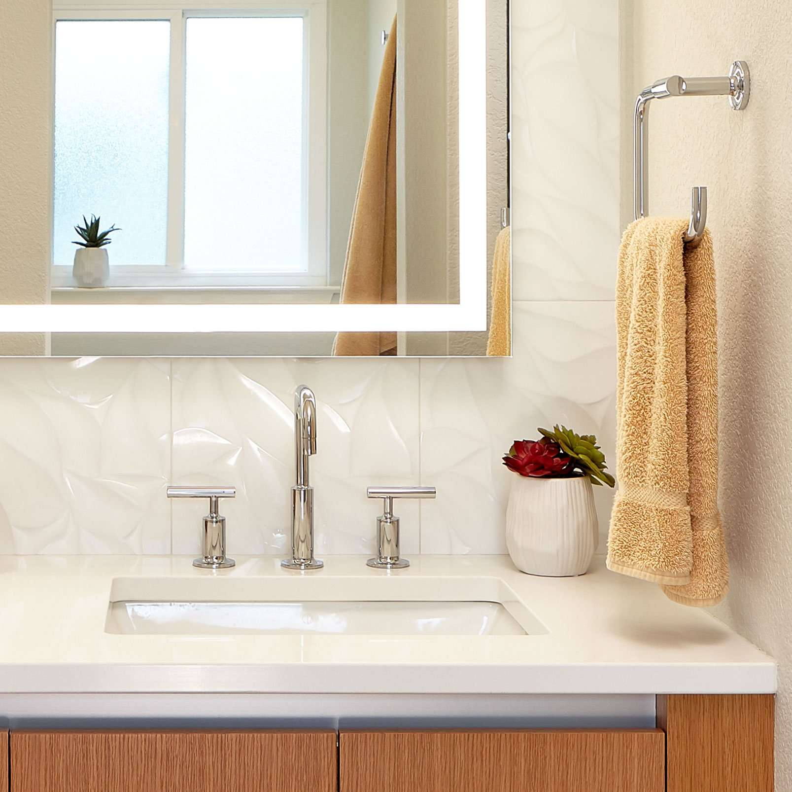 Bright sink with yellow towel hanging
